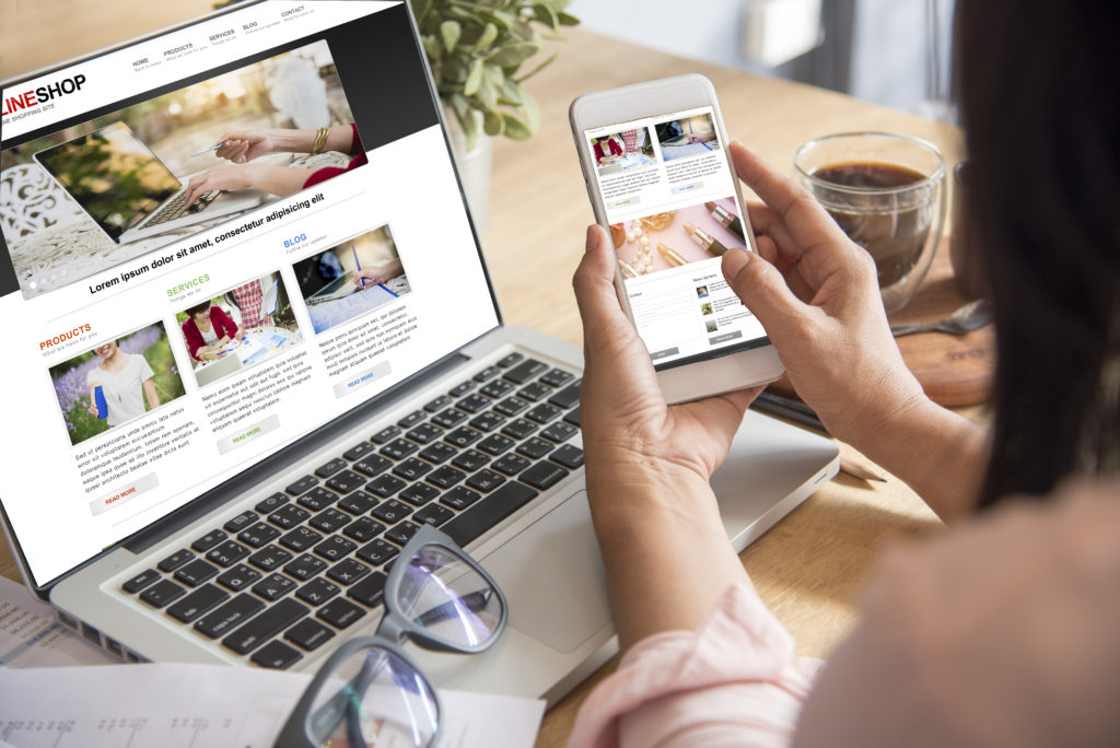 Online shopping on laptop and smartphone